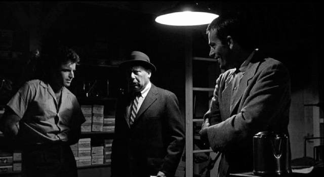 Vince Ryker (Vince Edwards) tries to sell what he thinks is a container of drugs, unaware that it's killing him in Irving Lerner's City of Fear (1959)