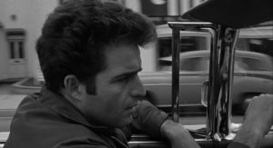 Escaped prisoner Vince Ryker (Vince Edwards) cruises the streets in search of a deal in Irving Lerner's City of Fear (1959)