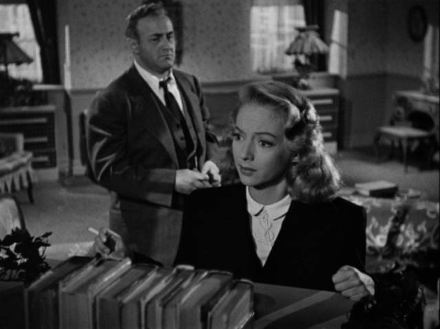 Inspector Koch (Lee J. Cobb) tells Nancy (Evelyn Keyes) that her sister's death was murder in Robert Rossen's Johnny O'Clock (1947)