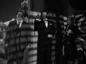 Cornered, Johnny O'Clock (Dick Powell) is ready to kill Inspector Koch (Lee J. Cobb) in Robert Rossen's Johnny O'Clock (1947)