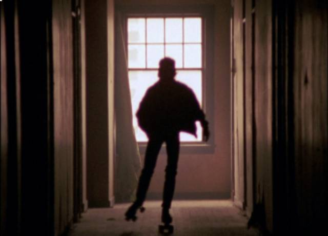 """""""Rat"""" skates in the empty halls of an abandoned hotel in Martin Bell's Streetwise (1984)"""