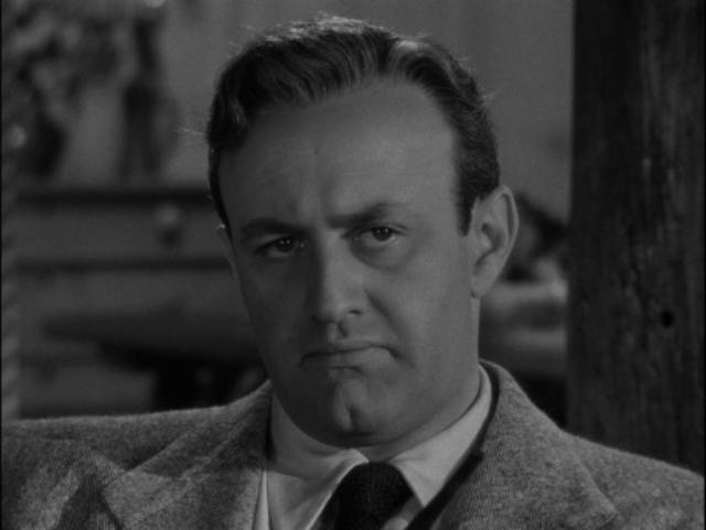 Psychologist Dr. Andrew Collins (Lee J. Cobb) digs into the symbolism of Al Walker (William Holden)'s recurring nightmare in Rudolph Maté's The Dark Past (1948)