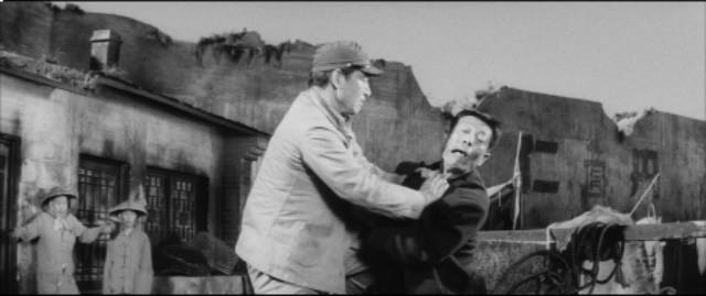 Discipline is maintained with physical violence in Masaki Kobayashi's The Human Condition (1959-61)