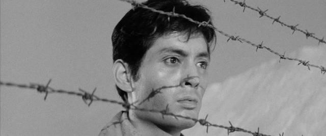 Kaji (Tetsuya Nakadai), as much a prisoner as the labourers he supervises in Masaki Kobayashi's The Human Condition (1959-61)