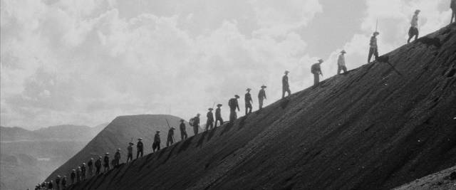 Chinese slave labourers dig for ore with their bare hands in Masaki Kobayashi's The Human Condition (1959-61)