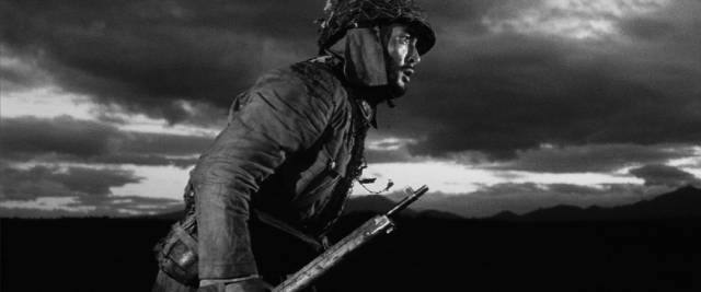 Forced by circumstance, Kaji (Tetsuya Nakadai) becomes a soldier despite his beliefs in Masaki Kobayashi's The Human Condition (1959-61)