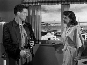 Edward Miller (Arthur Franz) misreads the friendliness of Jean Darr (Marie Windsor) in Edward Dmytryk's The Sniper (1952)