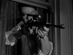 Edward Miller (Arthur Franz) fantasizes about shooting people from his rented room in Edward Dmytryk's The Sniper (1952)