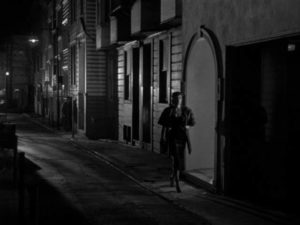 Edward Miller (Arthur Franz) follows Jean Darr (Marie Windsor) to the nightclub where she plays piano in Edward Dmytryk's The Sniper (1952)