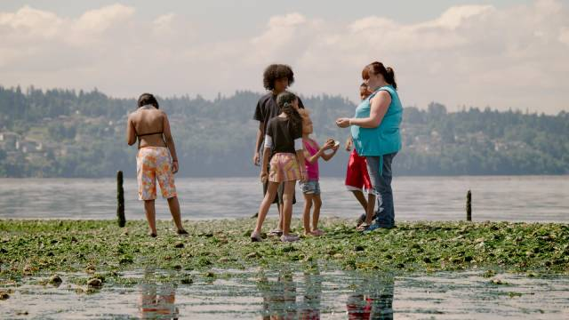 """""""Tiny"""" exploring tidal pools with some of her children in Martin Bell's Tiny: The Life of Erin Blackwell (2016)"""