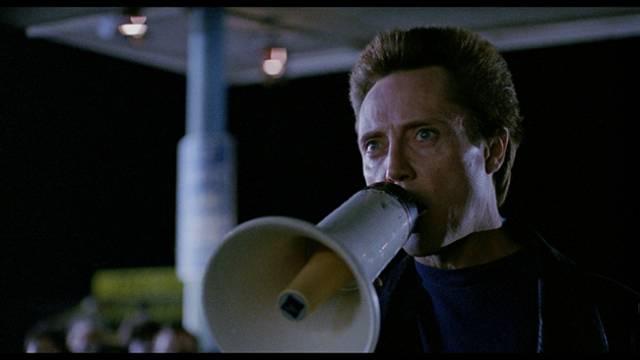 Detective Decker (Christopher Walken), an unorthodox cop, hunts a campus killer in Anson Williams' All-American Murder (1991)