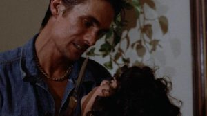 Smalltime criminal Scarface (Michael Wayne) goes after the wrong woman in Victor Ordonez et al.'s Alley Cat (1984)