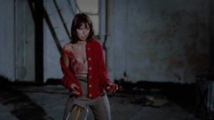 Billie (Karen Mani) takes on the whole gang when the police refuse to help in Victor Ordonez et al.'s Alley Cat (1984)