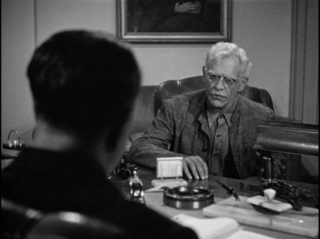 The warden offers Dr. John Garth (Karloff) a chance to continue his research in Nick Grinde's Before I Hang (1940)