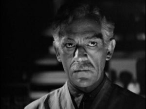Dr. Garth (Boris Karloff) is inadvertently possessed by a murderer's impulses in Nick Grinde's Before I Hang (1940)
