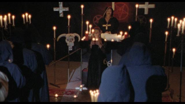 Judge Normad (William Smith) presides of Satanic child sacrifice in John De Hart's Champagne and Bullets (1993)