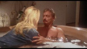 Writer-director-star John De Hart gives himself an opportunity to get naked in Champagne and Bullets (1993)