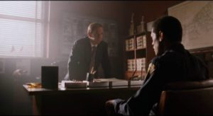 Agent Carver (Charles Martin Smith) persuades Russell (Laurence Fishburne) to go undercover in Bill Duke's Deep Cover (1992)