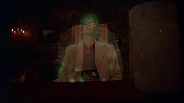 Medium Dr. Carl Farnsworth (David Warner) channels a hostile spirit in Donald P. Borchers' Grave Secrets (1989)