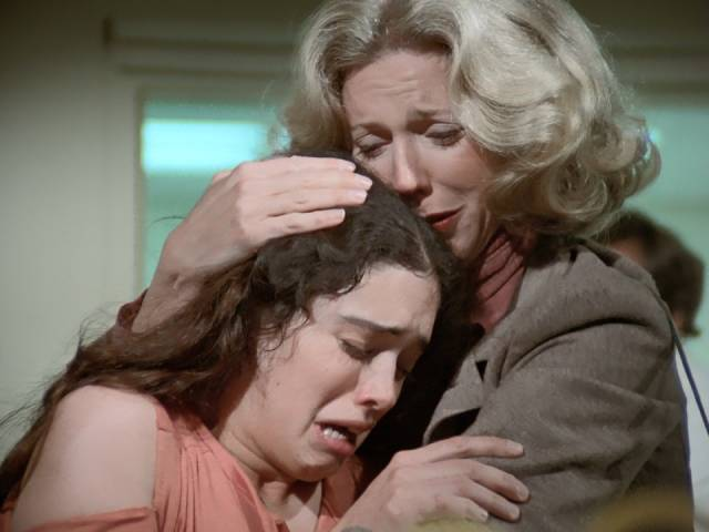 Mom (Blythe Danner) tries to comfort Gail (Kathleen Beller) after a vicious assault in Walter Grauman's Are You in the House Alone? (1978)