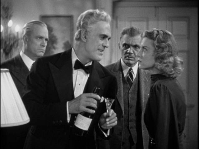 Dr. Savaard (Boris Karloff) cheerfully explains how he will kill all his guests in Nick Grinde's The Man They Could Not Hang (1939)