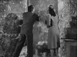 Dr. Mason (Roger Pryor) and Judith Blair (Jo Ann Sayers) discover Dr. Kravaal (Karloff) in an ice cave in Nick Grinde's The Man with Nine Lives (1940)