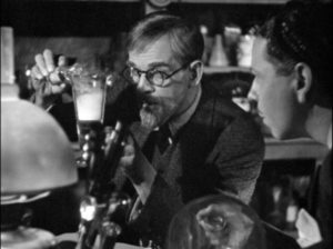 Revived, Dr. Kravaal (Boris Karloff) resumes his research in Nick Grinde's The Man with Nine Lives (1940)