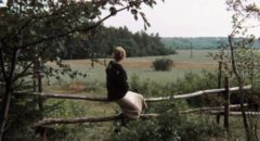 The mother (Margarita Terekhova) watches the road her husband may return on in Andrei Tarkovsky's Mirror (1975)