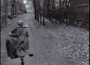 The mother (Margarita Terekhova) hurries to the printing house, fearing she's made a dangerous mistake in Andrei Tarkovsky's Mirror (1975)