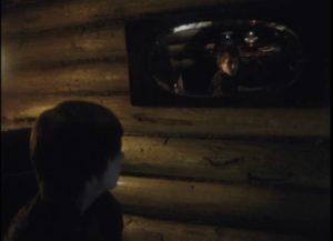Alexei (Ignat Daniltsev) waits as his mother negotiates the sale of her jewellery in Andrei Tarkovsky's Mirror (1975)