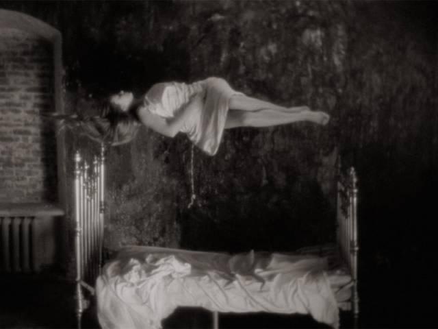 The mother (Margarita Terekhova) becomes weightless in Andrei Tarkovsky's Mirror (1975)