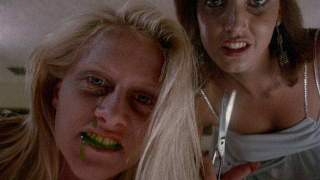 The experiments result in slime-spitting murderous zombies in Henri Sala's Nightmare Weekend (1985)