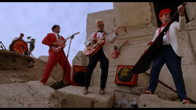 Among Buddy's rivals in Lance Mungia's Six String Samurai (1998) are The Red Elvises ...
