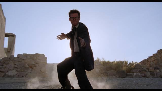 Kunbg-fu musician Buddy (Jeffrey Falcon) fights his way across the desert in Lance Mungia's Six String Samurai (1998)