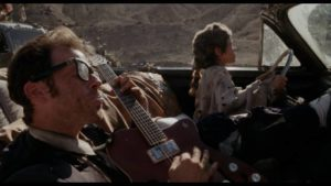 The Kid (Justin McGuire) proves helpful on the journey in Lance Mungia's Six String Samurai (1998)