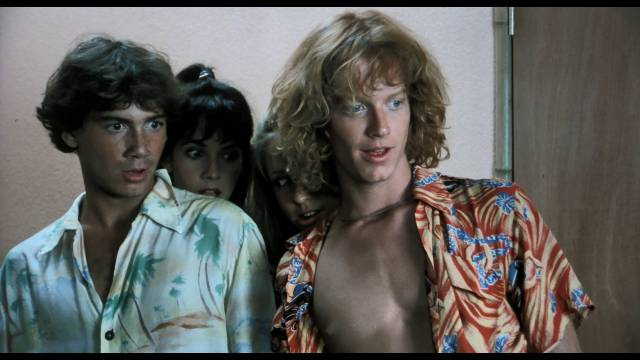 Surfer dudes Chuck (Eric Stoltz) and Bob (Jeffrey Rogers) can't believe whjat's happening on the beach in Randall Badat's Surf II (1983)