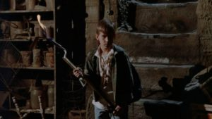 Willy (Chris Miller) confronts the monster living under the family home in Kevin S. Tenney's The Cellar (1989)