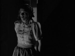 Housekeeper Mrs. Marcy (Dorothy Adams) discovers what's concealed in Dr. Blair (Boris Karloff)'s lab in Edward Dmytryk's The Devil Commands (1941)