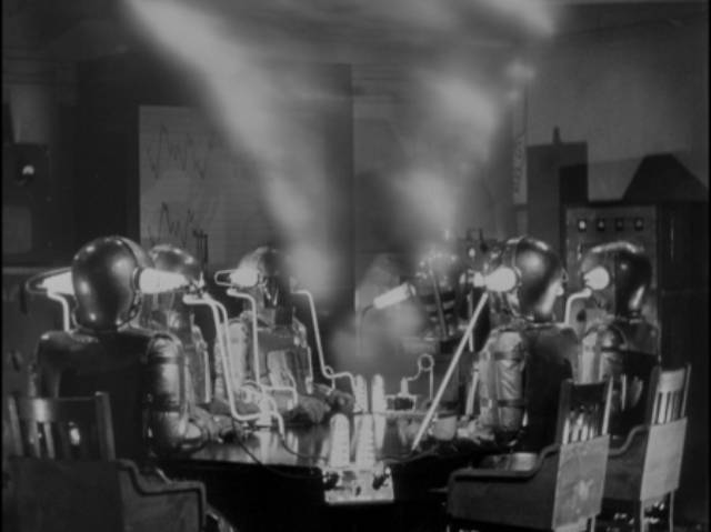 Dr. Blair (Boris Karloff)'s machine creates a vortex which opens a portal to another plane in Edward Dmytryk's The Devil Commands (1941)