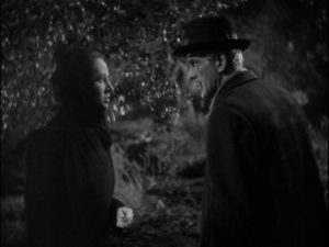 Dr. Blair (Boris Karloff) dislikes Mrs. Walters (Anne Revere)'s scheme to conceal the death of Mrs. Marcy (Dorothy Adams) in Edward Dmytryk's The Devil Commands (1941)