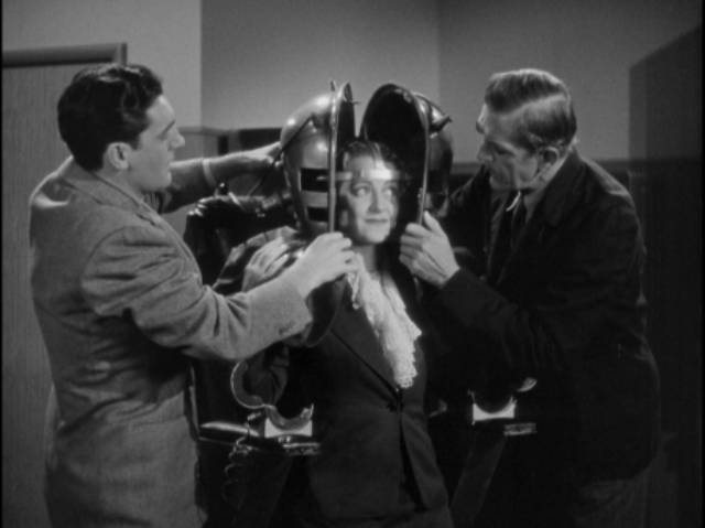 Helen Blair (Shirley Warde) cheerfully takes part in husband Dr. Julian Blair (Karloff)'s experiment in Edward Dmytryk's The Devil Commands (1941)