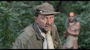 Nazi Klaus von Blantz (Donald Pleasence) seeks riches in the rainforest in Rene Cardona Jr.'s Treasure of the Amazon (1985)