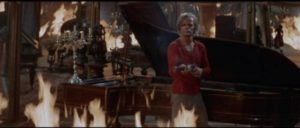 Gary Hamilton (Klaus Kinski) faces Acombar (Peter Carsten) amidst flames and mirrors in Antonio Margheriti's And God Said to Cain (1970)
