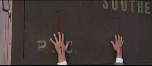Billy Kane (Venantino Venantini) cripples Richard Martin (Enrico Maria Salerno)'s hands in Massimo Dallamano's Bandidos (1967)
