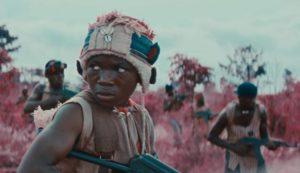 Agu (Abraham Attah) hallucinates as he goes into battle in Cary Joji Fukunaga's Beasts of No Nation (2015)