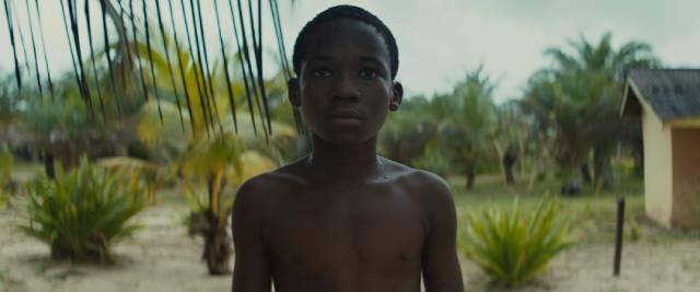 Liberated, Agu (Abraham Attah) stares into an uncertain future in Cary Joji Fukunaga's Beasts of No Nation (2015)