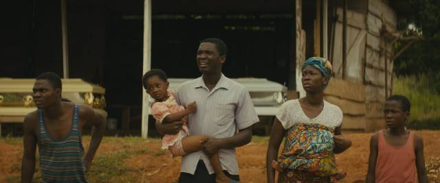 Agu (Abraham Attah)'s family try to escape as the army approaches their town in Cary Joji Fukunaga's Beasts of No Nation (2015)