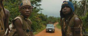 Agu (Abraham Attah) and Strika (Emmanuel Nii Adom Quaye) head towards battle in Cary Joji Fukunaga's Beasts of No Nation (2015)