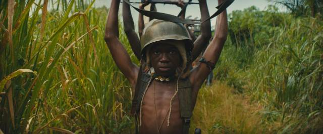 Following the collapse of the Commandant (Idris Elba)'s battalion, Agu (Abraham Attah) surrenders to UN troops in Cary Joji Fukunaga's Beasts of No Nation (2015)