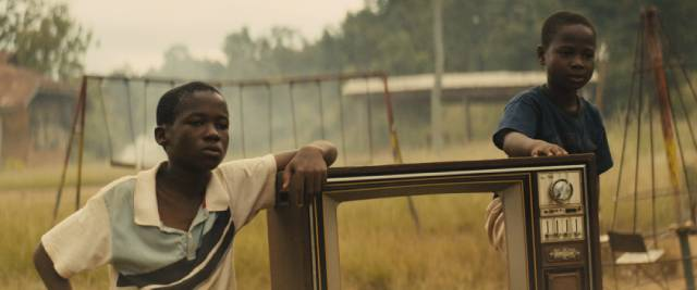 Agu (Abraham Attah) and his friends amuse themselves as war approaches in Cary Joji Fukunaga's Beasts of No Nation (2015)